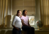04/30/2004 Denver-Manual High School students Liliana Flores, left, and Sherina Hardin studied the...
