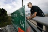 Denver District 4 police officer Eddie Padia (cq) stands on the Alameda overpass over I-25 ...