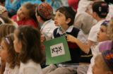 Daniel Melmed, 7, center, and his cousin, Samuel Friedman, 6, far right, students from Herzl/RMHA...