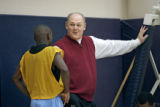 Denver Nuggets head coach George Karl (right) talks with Nuggets guard Earl Boykins (left) as he...