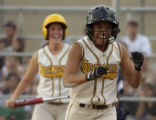Thomas Jefferson's Ivory Allen is all smiles after scoring a run in the sixth inning against...