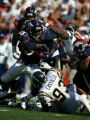 Denver Broncos' running back Ron Dayne rushes for a first down during first quarter action against...