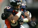 Denver Broncos Rod Smith makes a first down catch against San Diego Chargers 359 Donnie Edwards in...