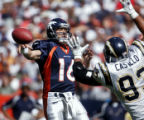 Denver Broncos' quarterback Jake Plummer is pressured by San Diego Chargers defensive end Luis...