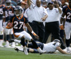 The Denver Broncos' Darrent Williams (#27, CB) avoids the tackle of the San Diego Chargers' Mike...