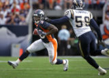 The Denver Broncos' Mike Anderson (#38, RB) looks for running room as the San Diego Chargers'...