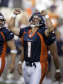The Denver Broncos' Jason Elam (#1, K) celebrates after a field goal in the closing seconds that...
