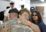Vicki Bosley, cq, Manzanola, is hugged by a soldier after Vicki's son, SSG Justin Vasquez was...