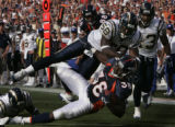 JPM0691-- Denver Broncos Mike Anderson, #38, leans for extra yardage as San Diego Chargers...