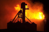 Flames shoot out of the top of Johnstown Feed and Seed Inc. on Colo. 60 in Johnstown, Colo....