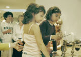 Denver, CO Oct 3, 2005  Leah Sidell, 8, lights candles as part of the celebration of Rosh Hashana,...