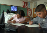 04/30/2004 Denver-Manual High School students Sherina Hardin, left, and Michael Segura work on a...