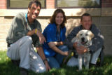Dr. Chris Horton, med student Sherry Hill, and Lance Armstrong pose with Lance's dog Rex, a yellow...