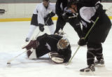 (Center) One of the Colorado Avalanche goalies makes a save during Avalanche practice at the...