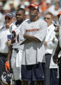 Denver Broncos cornerback Champ Bailey (center) was a spectator on the sidelines Sunday against...
