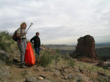 Rocky Mountain Adventure. Cindy Bell, left, scopes out hotspots to pick up trash at the outset of...