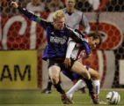 Colorado Rapids defensive forward, Nat Borchers,left, gets tangled up with  Chivas USA forward,...