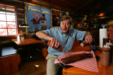 Bill Ferguson, president of Famous Dave's, dives into a slab of Pit-Smoked St. Louis-Style...