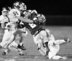 JPM232 -  Arvada West Wildcats Matt Rainey, #55, left, and Jed Herbien, #8,  tackle Columbine High...