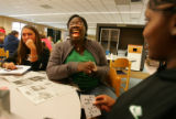 University of Colorado student Tayo Adeeko, cq, 18, center, of Westminster, laughs with fellow...