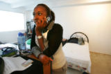Bethany Andrews, cq, 20, a student at the University of Colorado listens to her voicemail in...