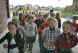 Students at Second Creek Elementary School line up after recess, Thursday morning September 22,...
