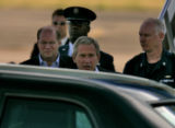 U.S. President  George W. Bush, is greeted after stepping off Air Force One as he arrives at...