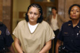 Natalie McFarlane enters denver County court on Friday September 23,2005. McFarlane is charged in...