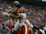 Denver Broncos Ashley Lelie catches a touchdown pass over Ade Jimoh in the secon quarter against...