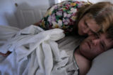 Debbie Miller (cq) gives her son Brian Miller a wake-up hug before starting his daily routine. ...