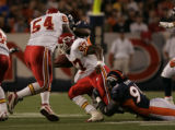 Denver Broncos defensive end Courtney Brown drags down Kansas City Chiefs running back Larry...