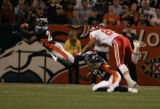Denver Broncos safety Nick Ferguson stretches unsuccessfully in an interception attempt on a pass...
