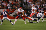 Denver Broncos safety Sam Brandon tackles Kansas City Chiefs  tight end Tony Gonzalez during first...