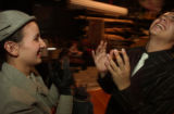 (DENVER, Colo., April 15, 2004) Emily Hare plays a hand clapping game with Elvis Nunez backstage...