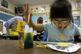 For the Ref C and D Project:  Shot on 9/20/2005 -   Abbie Maben tries to decide which crayon to...