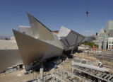 Construction continues on  the Denver Art Museum's Frederic C. Hamilton Building, background, and...