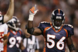 Denver Broncos linebacker Al Wilson celebrates a fumble recovery by defensive end Courtney Brown...