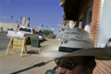 Claude Alexander (cq), 74, of Cortez passes time on a bench on Main Street in downtown Cortez, Co....