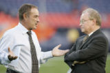 ABC commentator Al Michaels, left, speaks with Bob Moore (cq), public relations director for the...