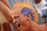 Denver Broncos fan Erik Moberg, 21, of Ouray, Colo. hams it up for a television camera prior to...