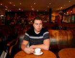 (NYT64) MOSCOW -- Oct. 11, 2005 -- STARBUCKS-RUSSIA -- Sergei A. Zuykov, a lawyer, at the Coffee...