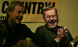 Long time football radio announcer, Larry Zimmer (cq),right, jokes with Gary Barnett (cq), as...