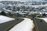Cars travel on E-470 south of Smokey Hill Rd, going past new neighborhoods that were built in the...