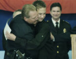 Denver, CO Sept. 29, 2005  Brandan Creason gets a hug from his father Denver police officer Del...