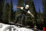 At the terrain park, Scottie Kees, 24 gets practise in on his board. Friday, Loveland Ski Area...
