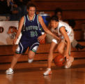 Lakewood, Colo., photo taken January 28, 2005- Lakewood's Jordie Goodall (right in white) looses...