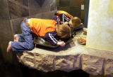 (Denver, Co.-Jan. 13, 2005)  Christian Wooldridge, 4, drinks from the first floor bathroom sink. ...