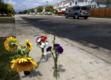 (Fort Collins, Colo., July 25, 2004) A flower memorial and scorched pavement mark the spot on...