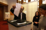 (Irvine, Calif., Jan. 29,2005) Ahmad Dizayee  of Lakewood, Colorado  casts his vote for the Iraq...