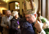 (DENVER, CO. JANUARY 30, 2005) Bishop Gomez (right) is hugged as he says his farewells to...